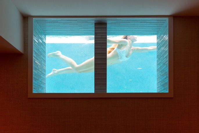 Window with underwater pool view