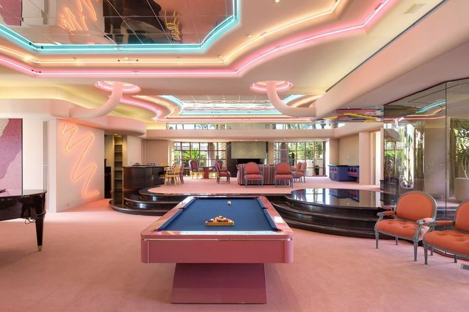 Game room with pink pool table in Indian Wells, CA, mansion