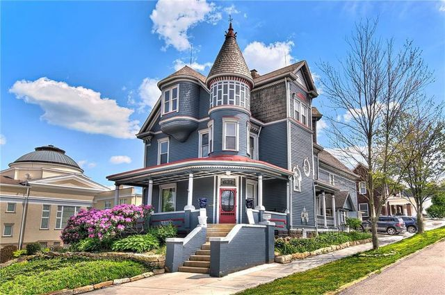Exterior of blue Victorian home