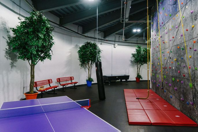 There is ping-pong and a rock climbing wall.