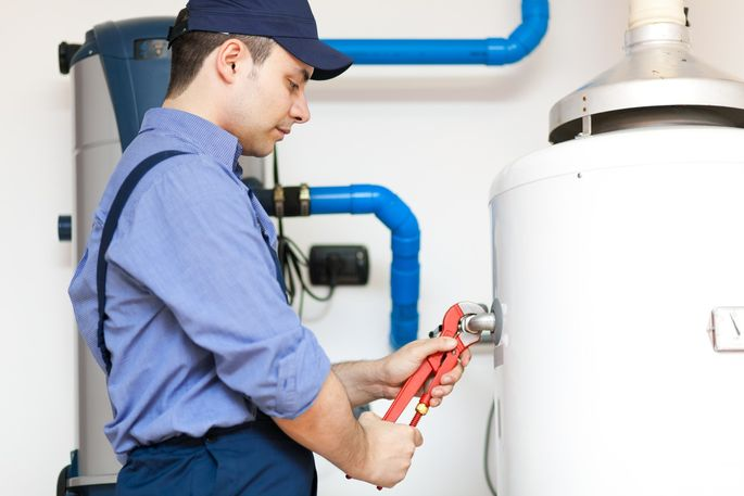 Technician repairing an hot-water heater