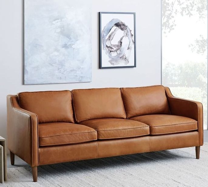 The clean lines of a leather sofa go perfectly with a modern organic decor scheme.