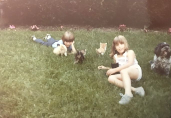 Me and my brother with our pets in front yard