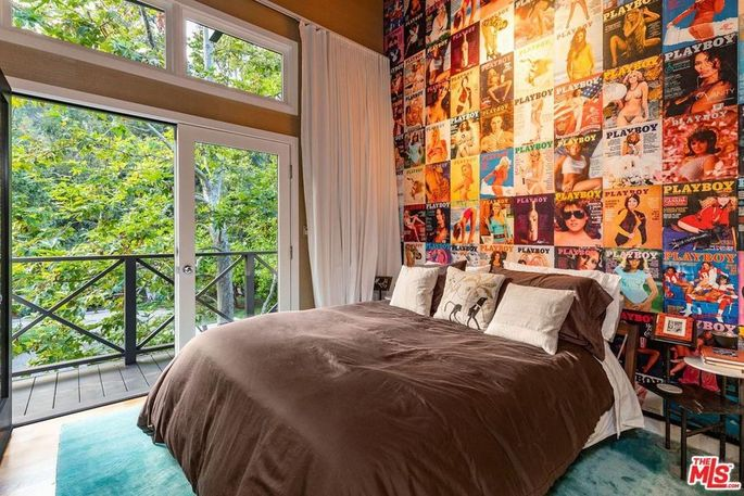 Bedroom with Playboy covers adorning the wall