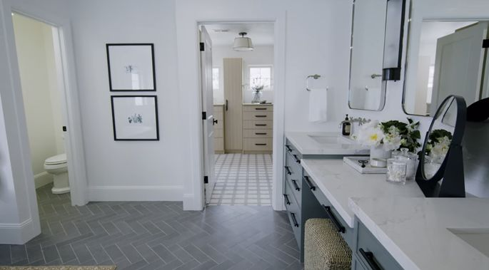 The tile in the bathroom and the carpeting in the closet work together to create an elegant look.