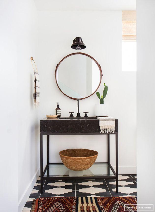 Sleek stone atop a glass frame equals a modern vanity.