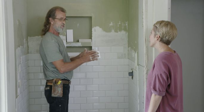 David and Erin talk tile in Kendall's new bathroom.