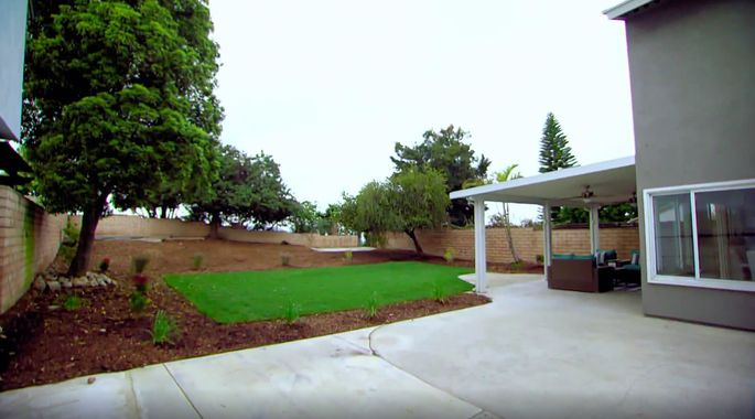 This yard looks much cleaner after a bit of landscaping.