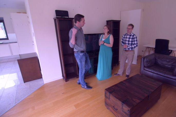 """Elizabeth and Jeff Newcamp pretended to tour the Delft house they already lived in with their """"relocation expert,"""" who was actually their neighbor, Michael (left)."""