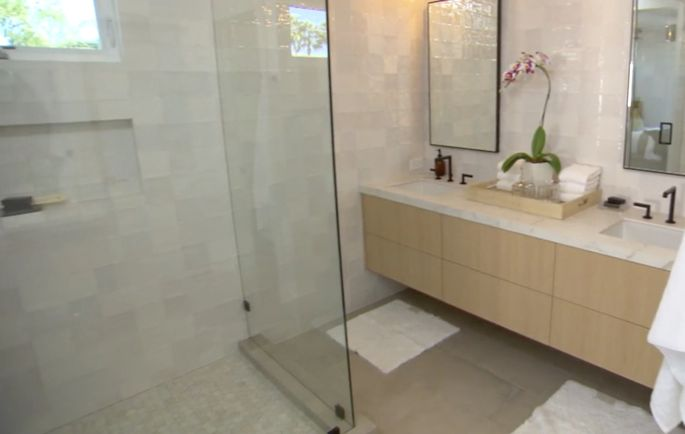 Without a tub, the bathroom has space for a giant walk-in shower and a double vanity.
