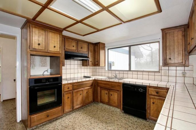 This closed-off kitchen is like a step back in time.