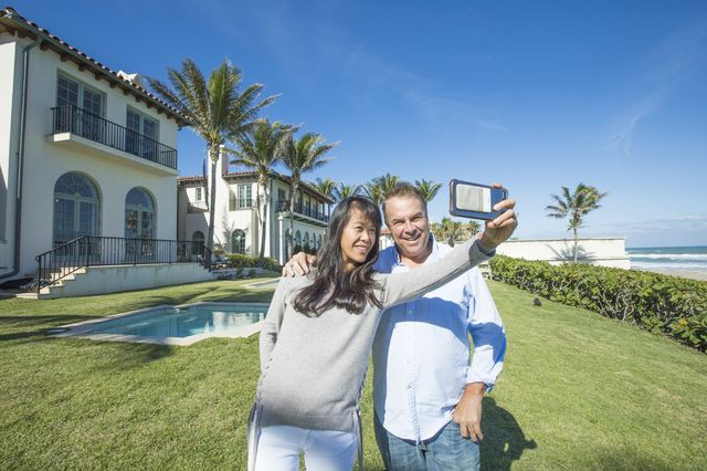 Jeff Greene and his wife, Mei Sze Greene, at their oceanfront estate.
