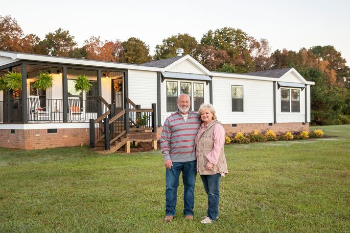 New owners Mesha and Jerome Mayfield outside their farmhouse-style Lulamae model