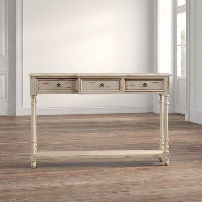 Try this slender piece, with a distressed finish, along the back of your couch.
