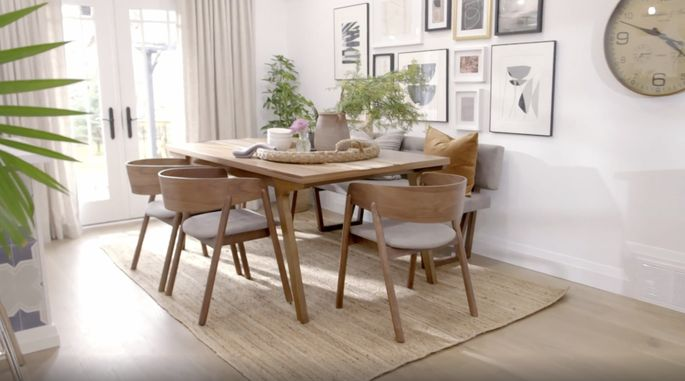 This wood dining table brings a warmer feel to the home.