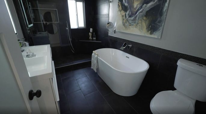 The flippers wanted a black bathroom. Of course, El Moussa loved the look!