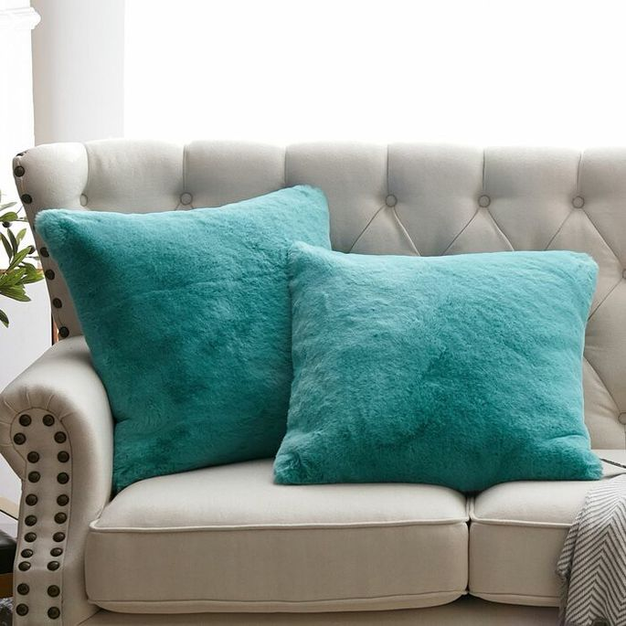 Make your throw pillows cozier with fuzzy covers.
