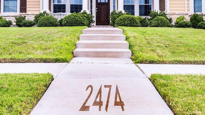 Stenciled sidewalk house number