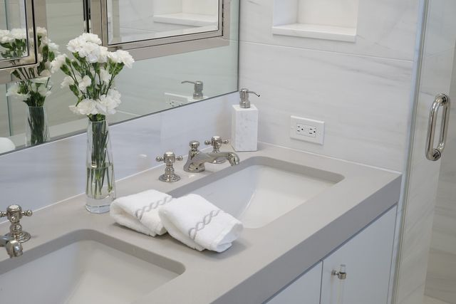 A few flowers and hand towels are all you need on the counter.