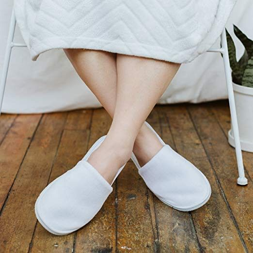 Offer guests slippers they can wear in the house.