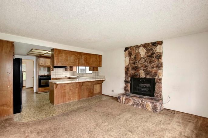 That old fireplace dated the entire space.