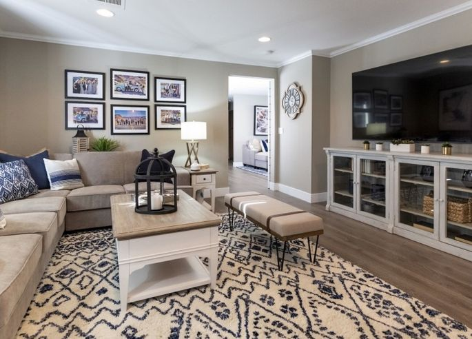 This stylish media/family room can also serve as a guest room.
