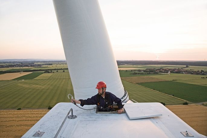 Maintenance worker on wind ability  station