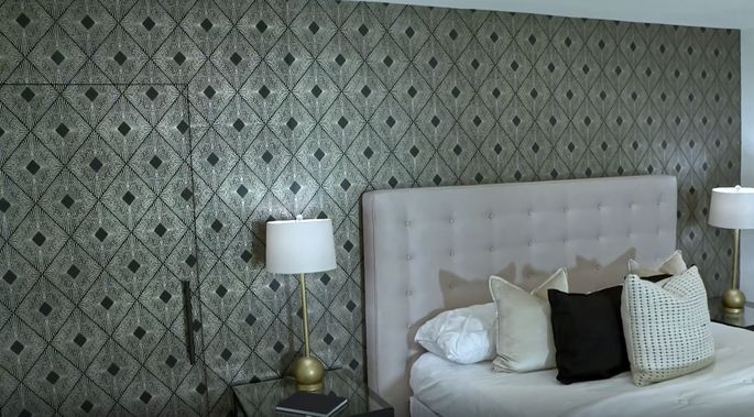 This wallpaper gives the bedroom extra style.