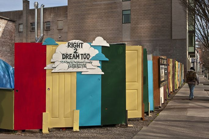 A display of colorful doors masked a Portland homeless encampment in 2012.