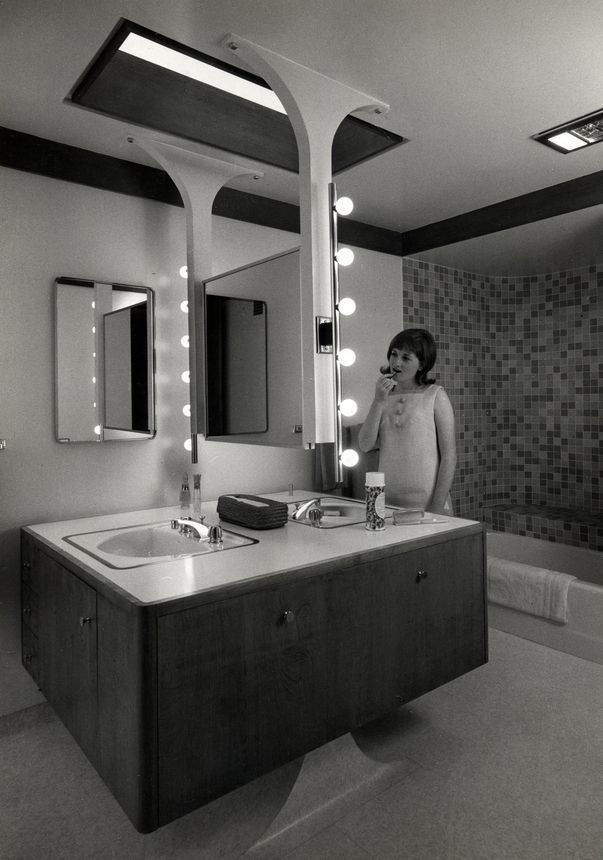 A model putting on lipstick in the home's unusual bathroom