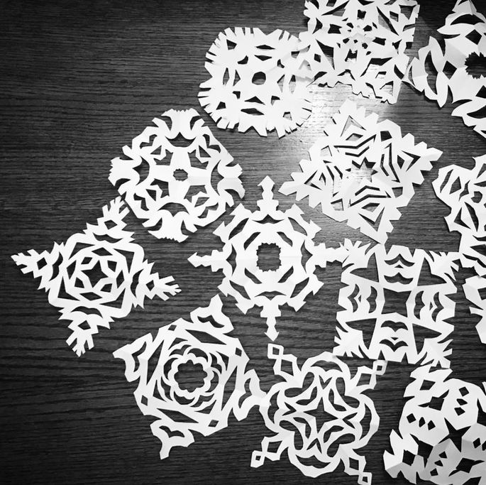 Cutting out paper snowflakes to tape to your window is a good alternative to spray-on snow.