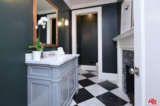 Powder room with marble fireplace