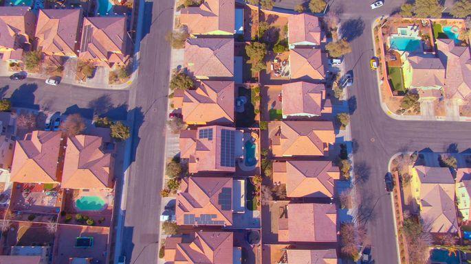 TOP DOWN: Flying over row houses in a luxury suburban neighborhood in Nevada.