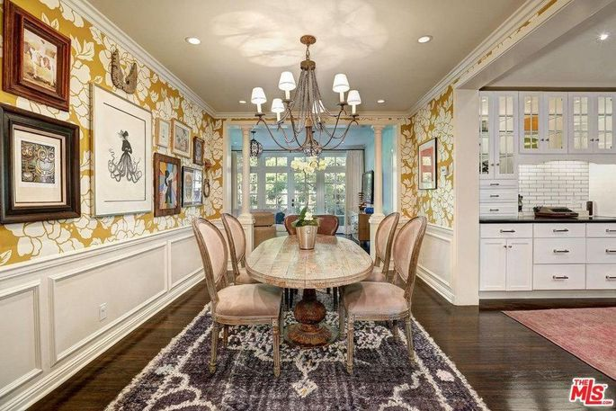 Dining room with vibrant floral wallpaper