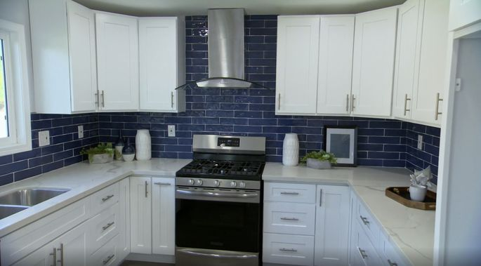 This tile is bold for a small kitchen, but it looks good!