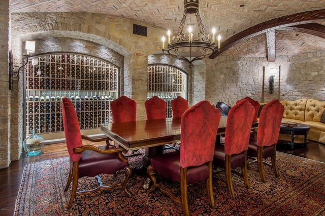Wine vault and tasting room with temperature-controlled walls and 2,500 bottle storage