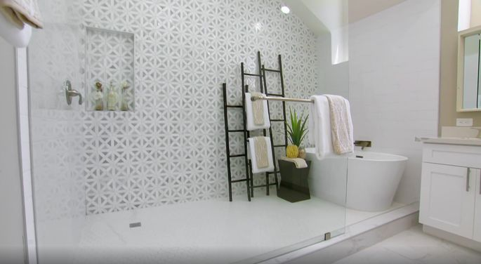 This combined bathtub/shower section is unique and beautiful.