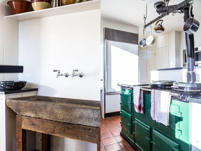 A stone trough used as a sink is original to the house The owners replaced the kitchen countertops.