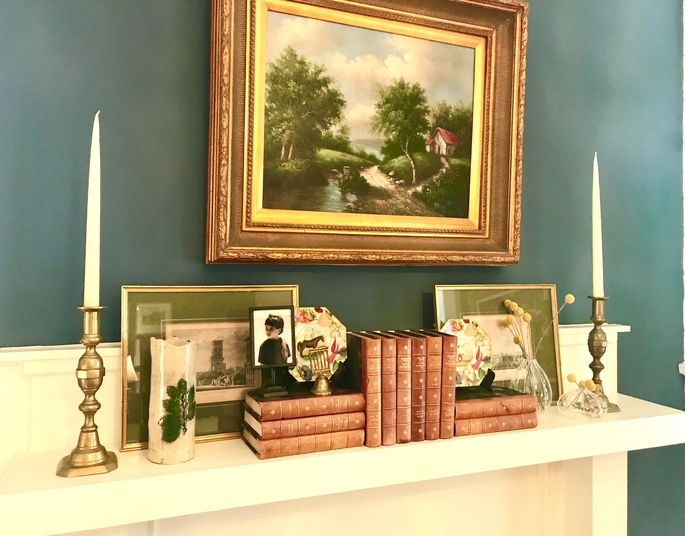 A grand oil painting is right at home with found objects and treasured books.