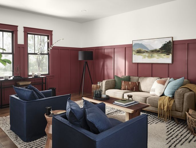 Crimson walls highlight classic molding and window frames.
