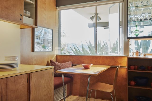 A floating desk in a 1953 glass house designed by Richard Neutra; the two small bedrooms have pop-up vanities.