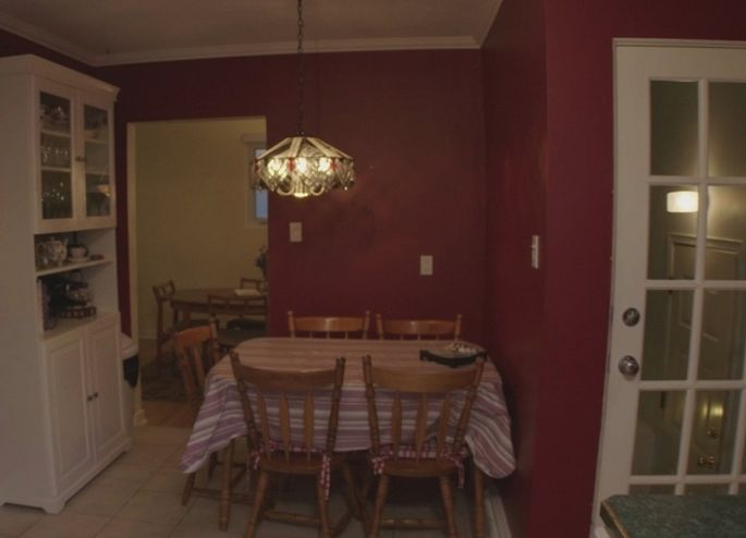 "Dining room with an ""angry red"" wall"