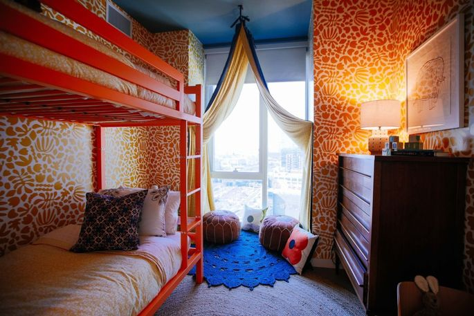 A kids bedroom with bunk beds in a model apartment in the Jackson Park development.