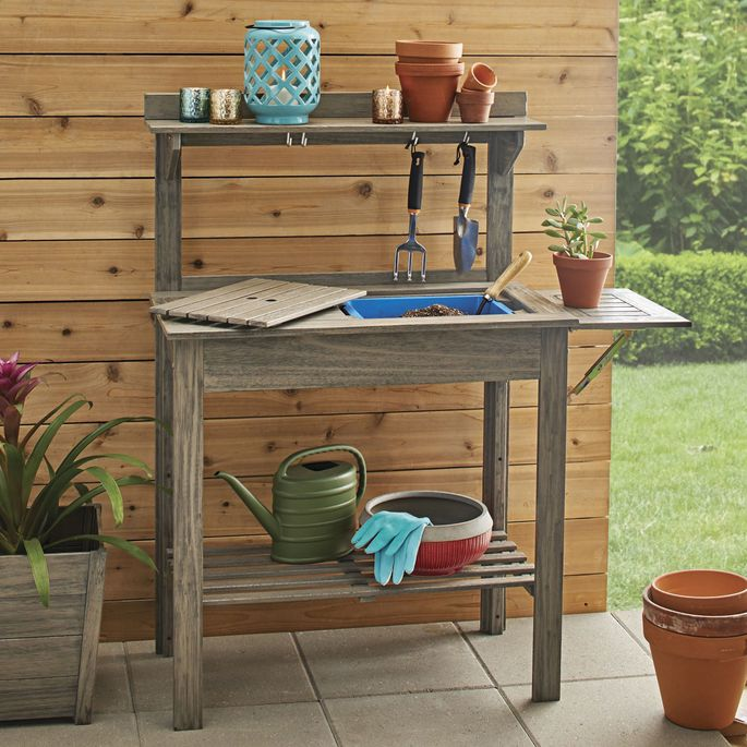 Extend your workspace with the fold-up side section of this bench.
