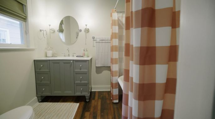 These plaid curtains bring a rugged charm to the bathroom.