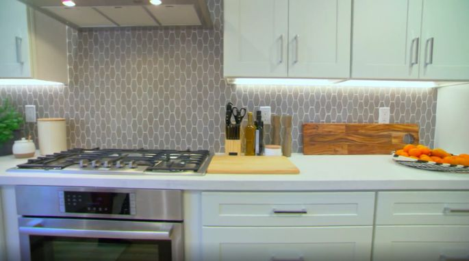 This gray backsplash is a much better choice than the white subway tile they almost went with.