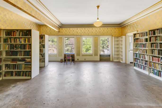 A bedroom transformed into a library. Much of the school library's collection remains with the property.