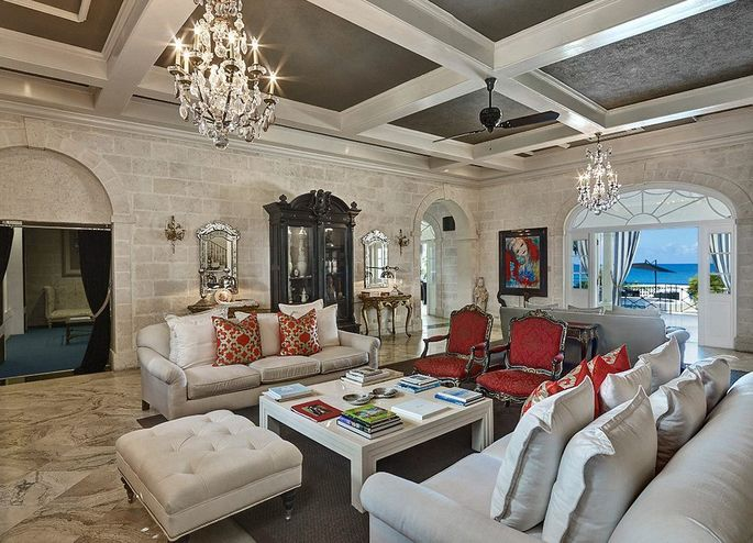 The stately living room is appointed with one-of-a-kind furniture.