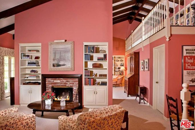 Master suite with fireplace and loft library
