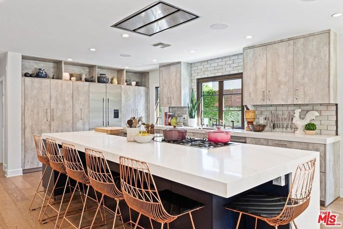 Kitchen with island with cooktops